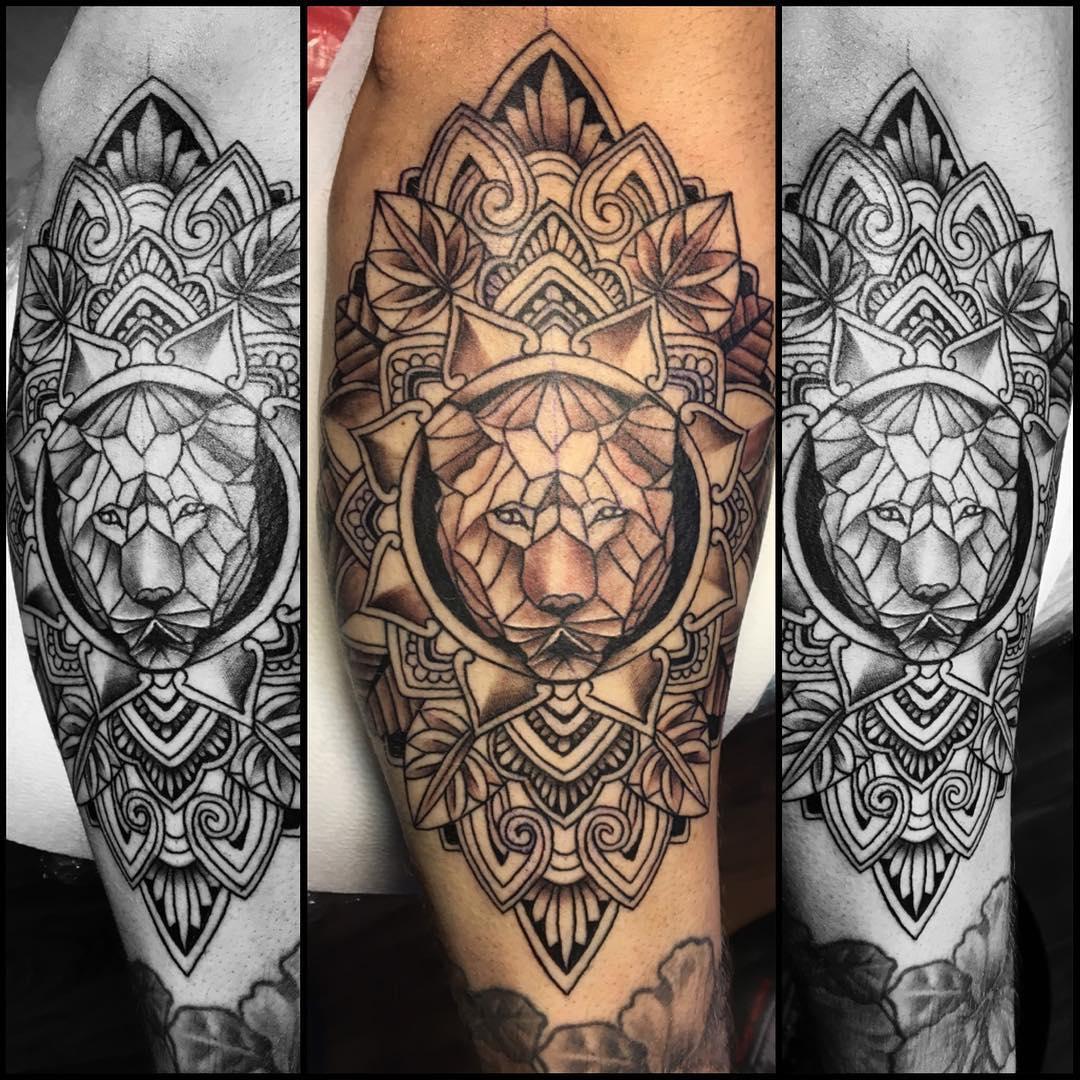 Lion Hand Tattoo Designs