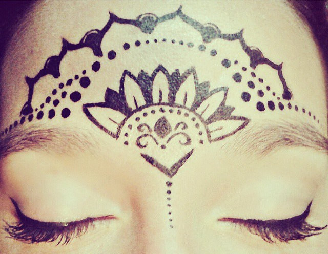 Creative Mandala Tattoo on face