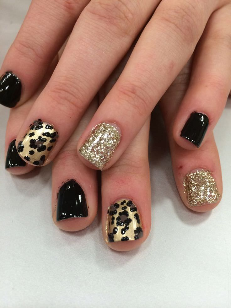 Black And Gold Leopard Nail Design