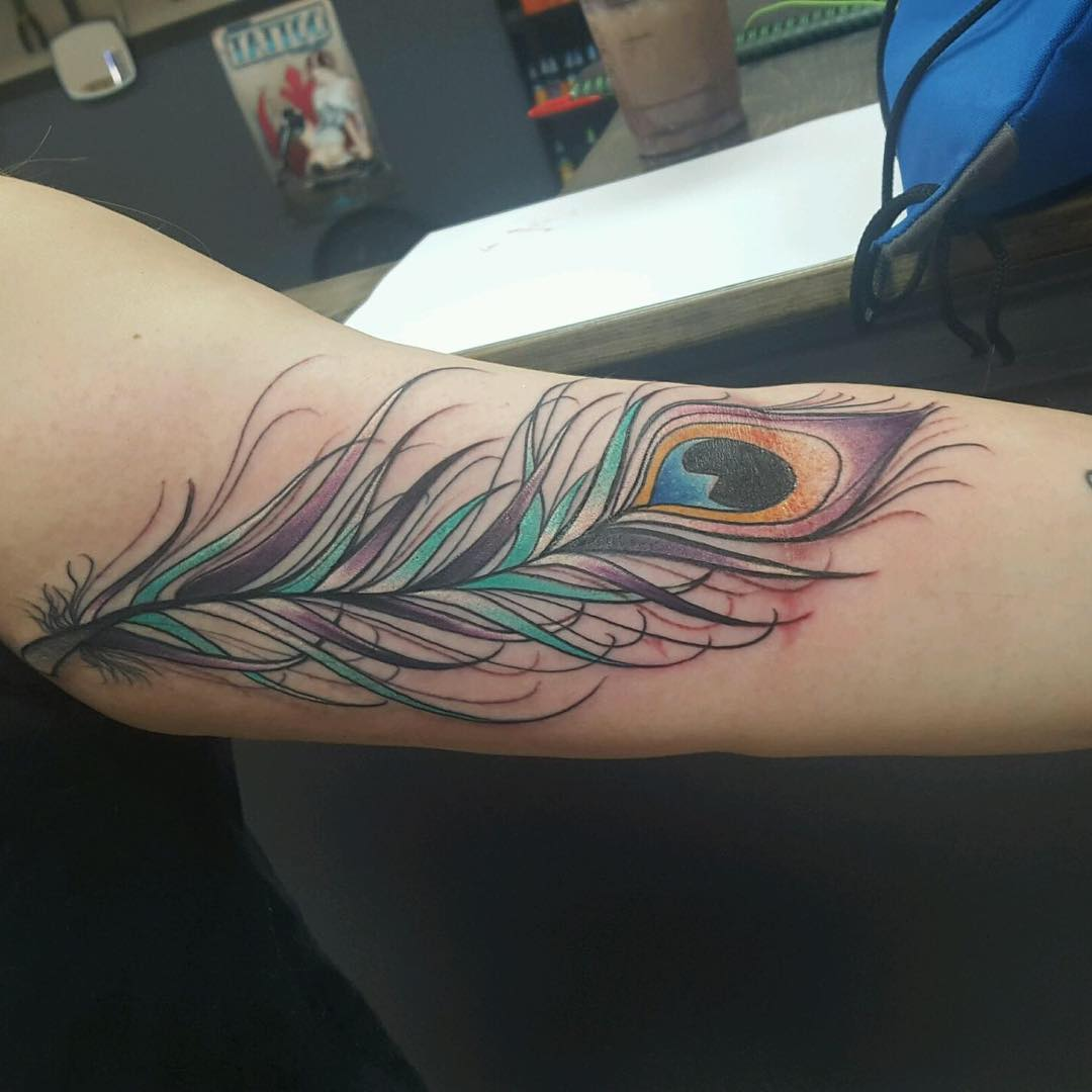 beautiful feather tattoo on sleeve