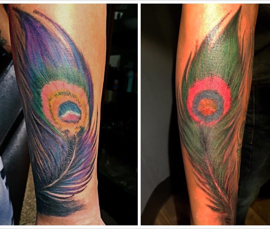 hand peacock feather tattoo