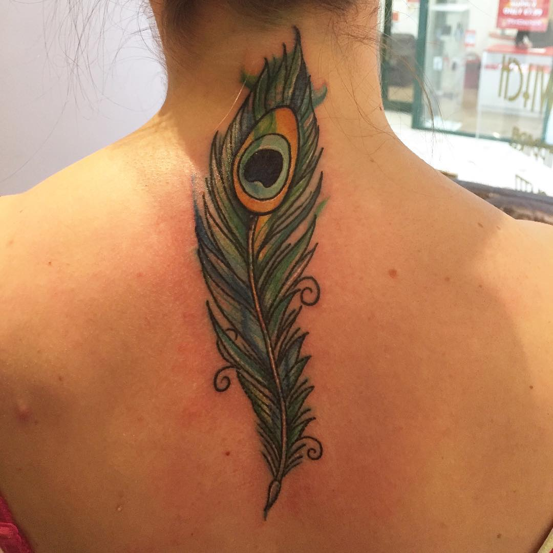 peacock feather tattoo on neck