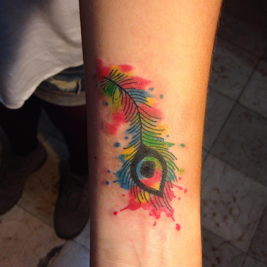 peacock tattoo on arm