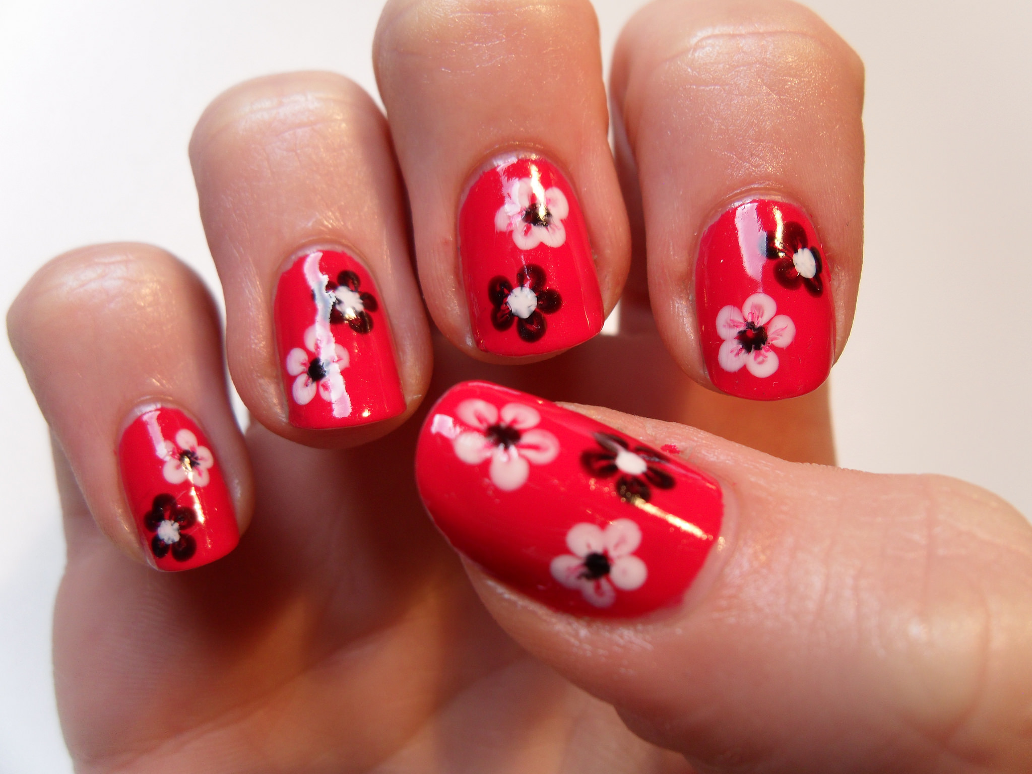 Red Floral Finger Nail Design