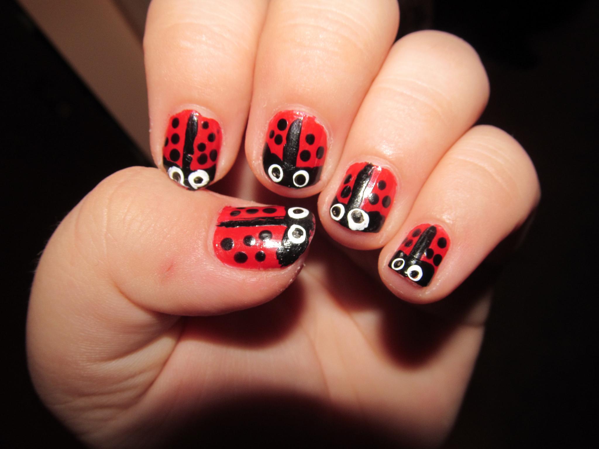 red ladybug nail design