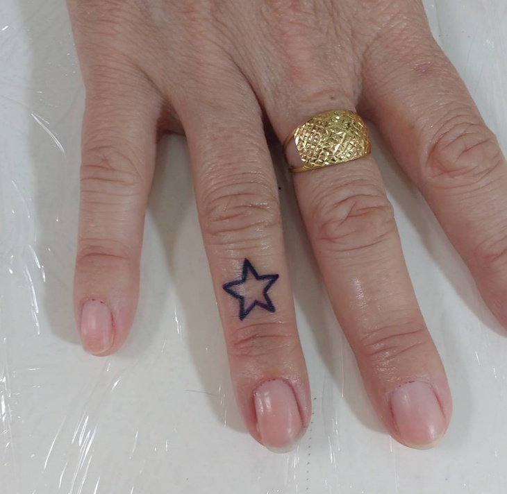 Cute Star Tattoo on Finger