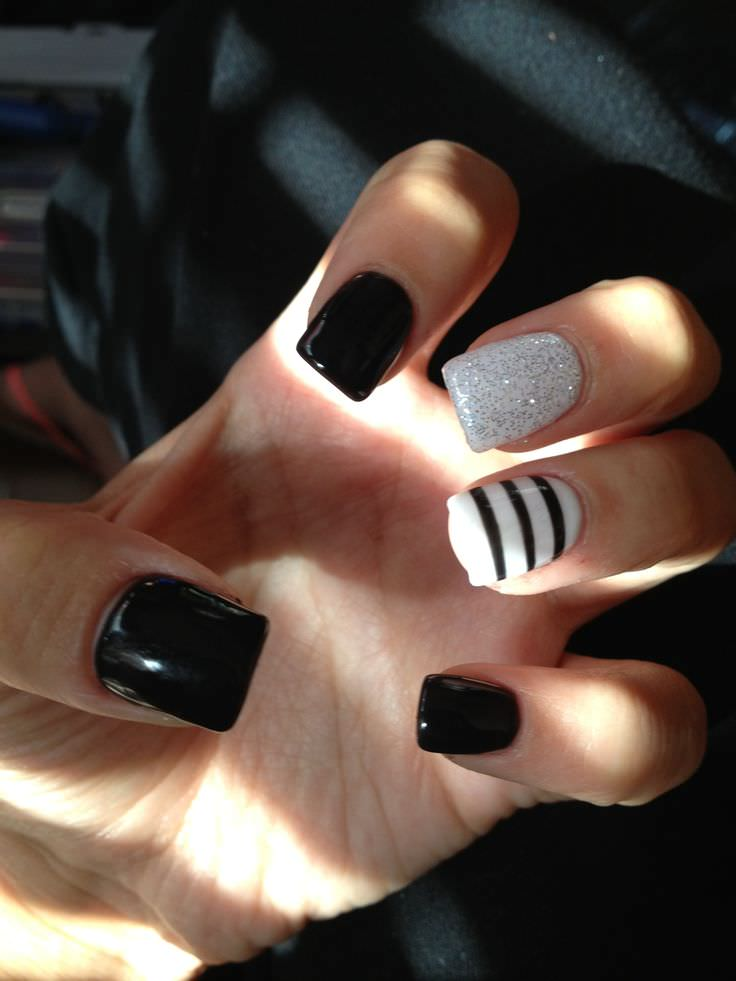 black and white nail paint with glitter and strips