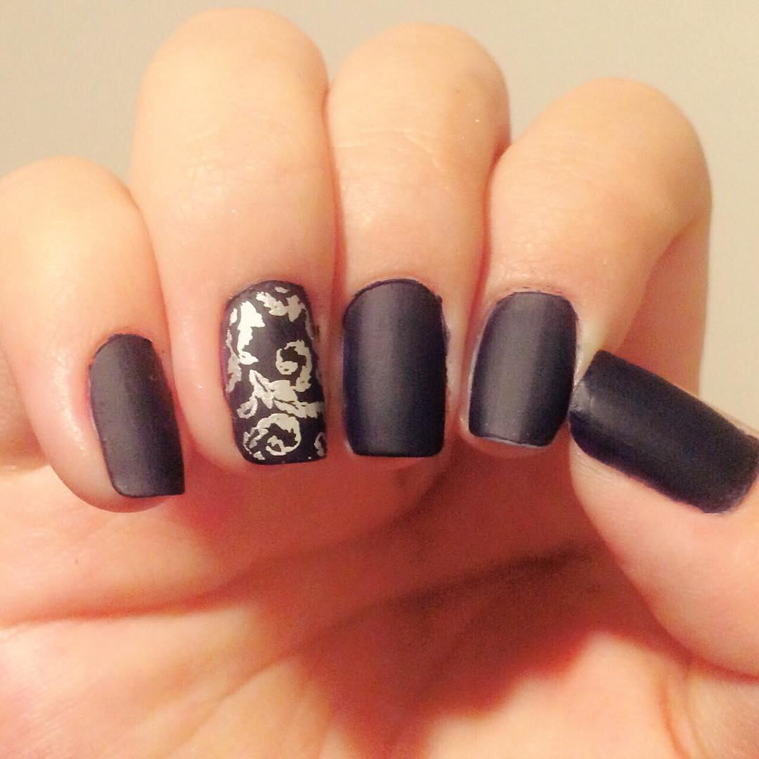 Stressing Black Nail Design