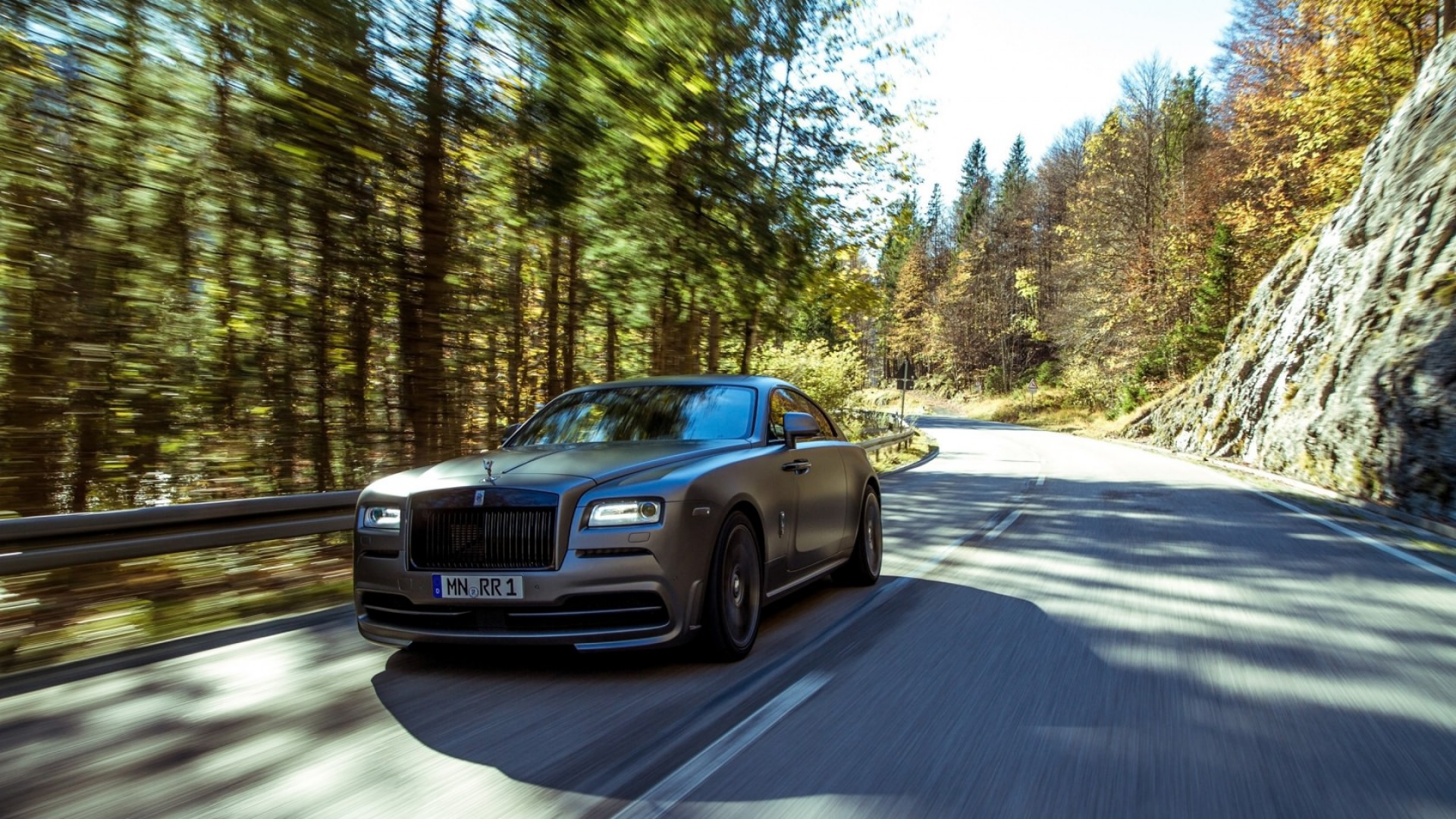 Speeding Rolls Royce Car Background