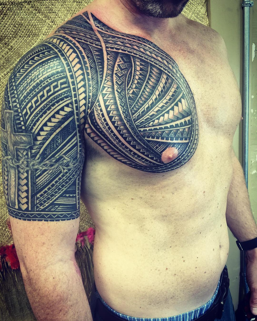 polynesian chest and half sleeve tattoo