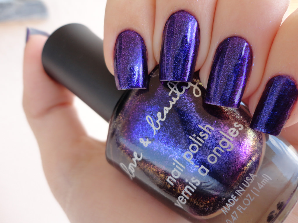 metaphorical dark purple nail design