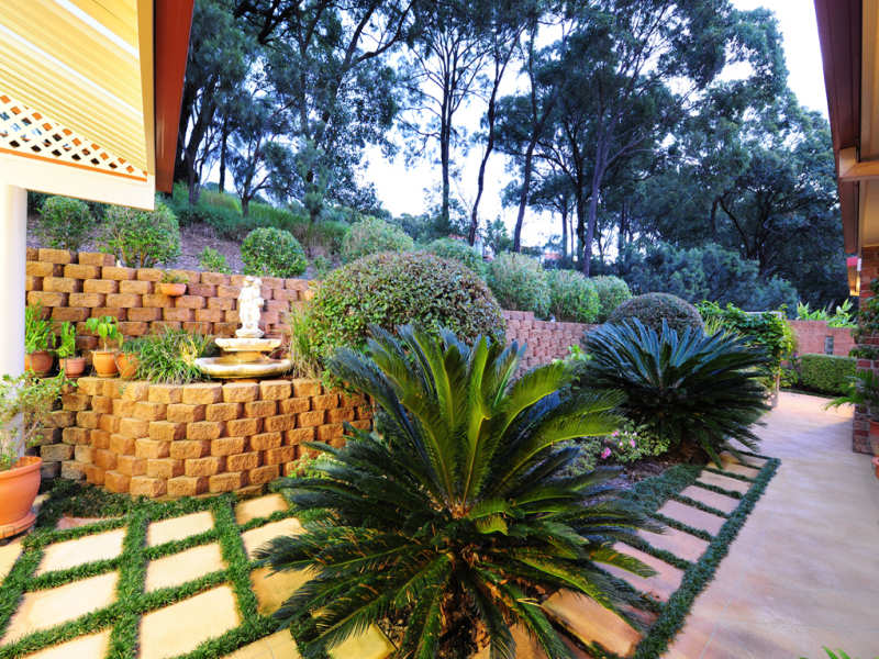 Landscaped Brick Wall Garden Design