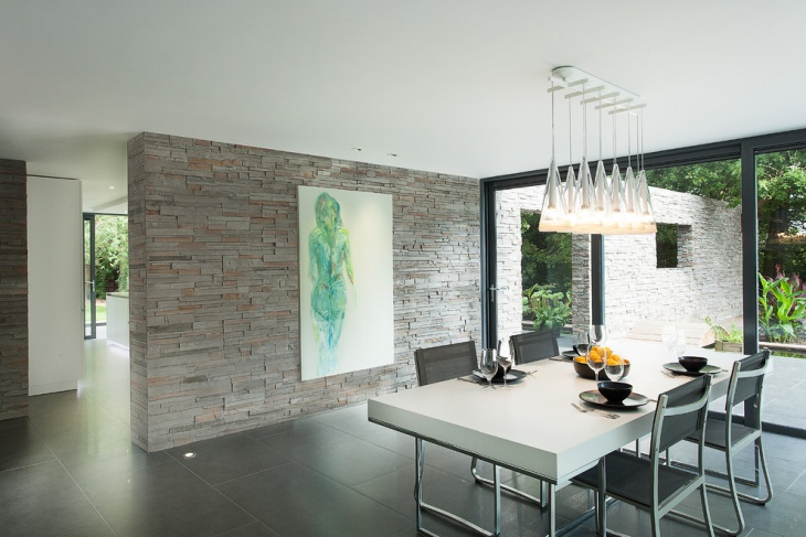 Modern Dining Room with Stone Wall