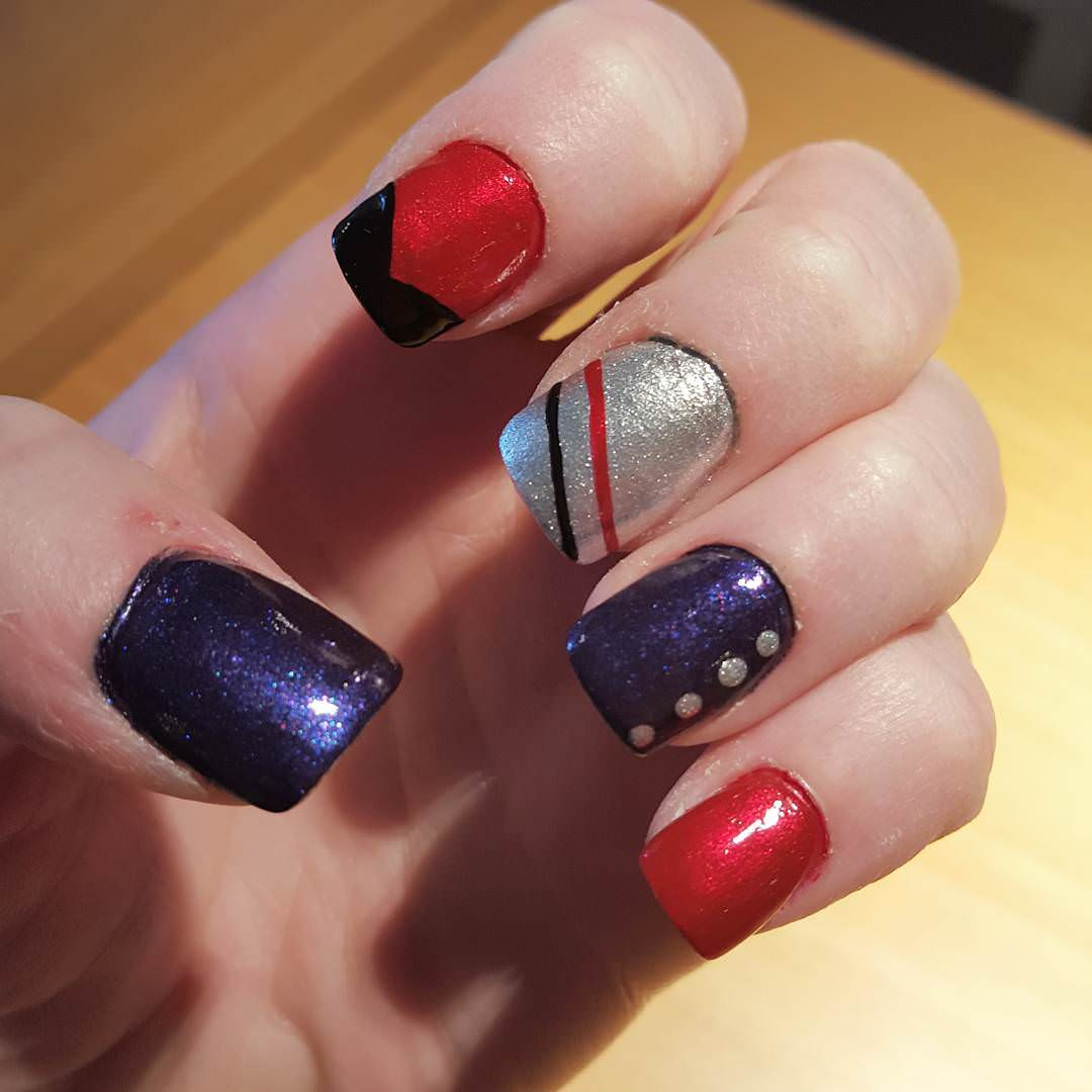 shining black and red nail design