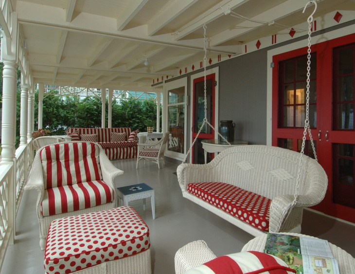white porch swing with colorful cushions
