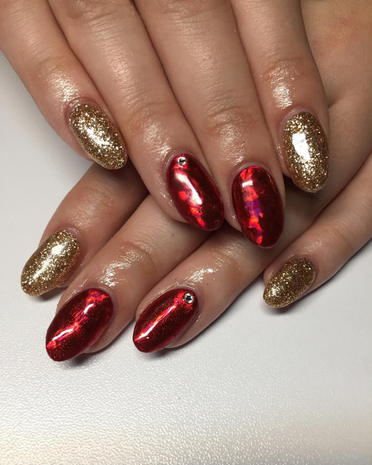 shining red and gold nail design
