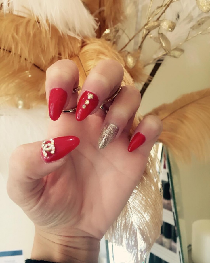 sharp gold and red nail design