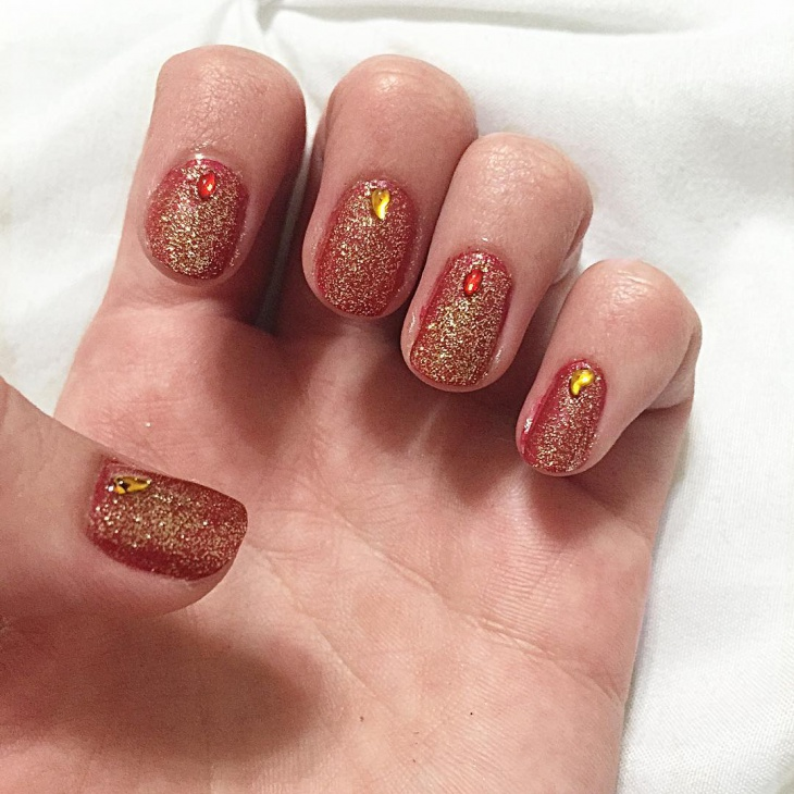 attractive red and gold nail design