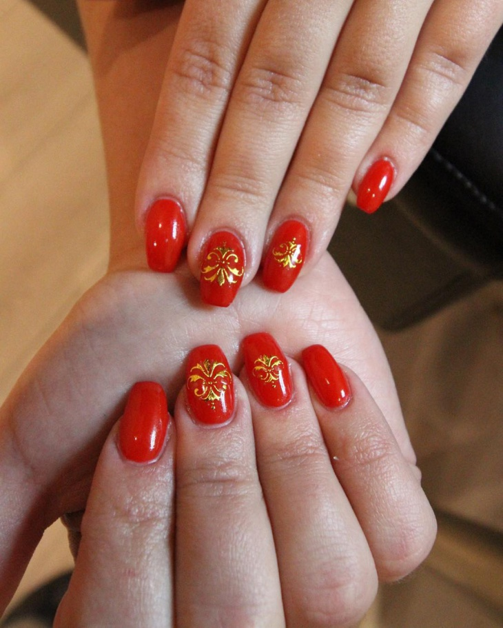 trendy red and gold nail design