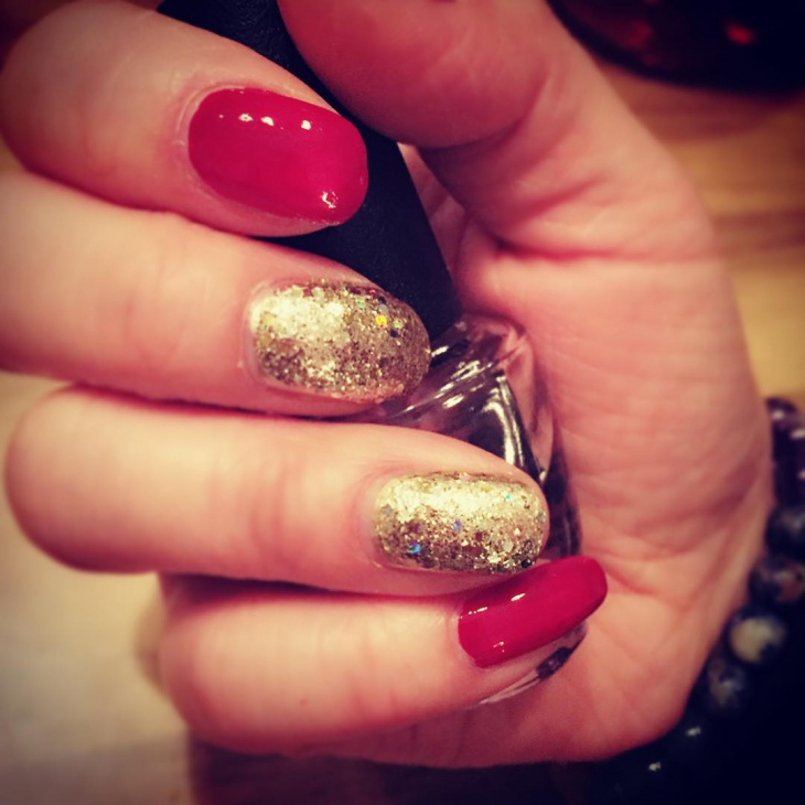 glittering red and gold nail design
