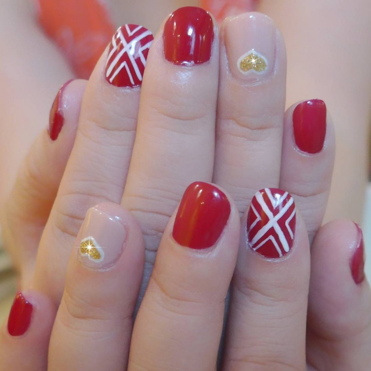 asymmetric red and gold nail art
