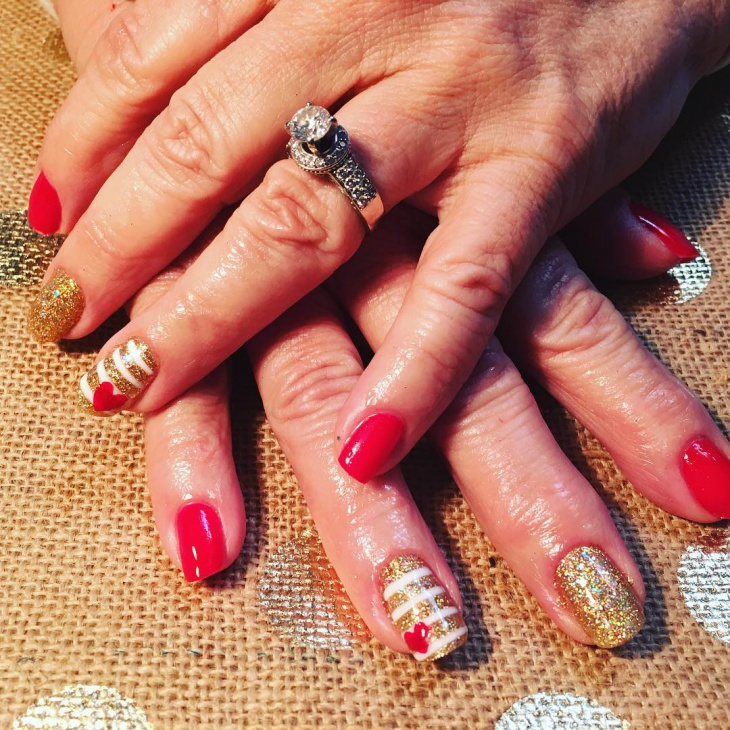 striped red and gold nail art