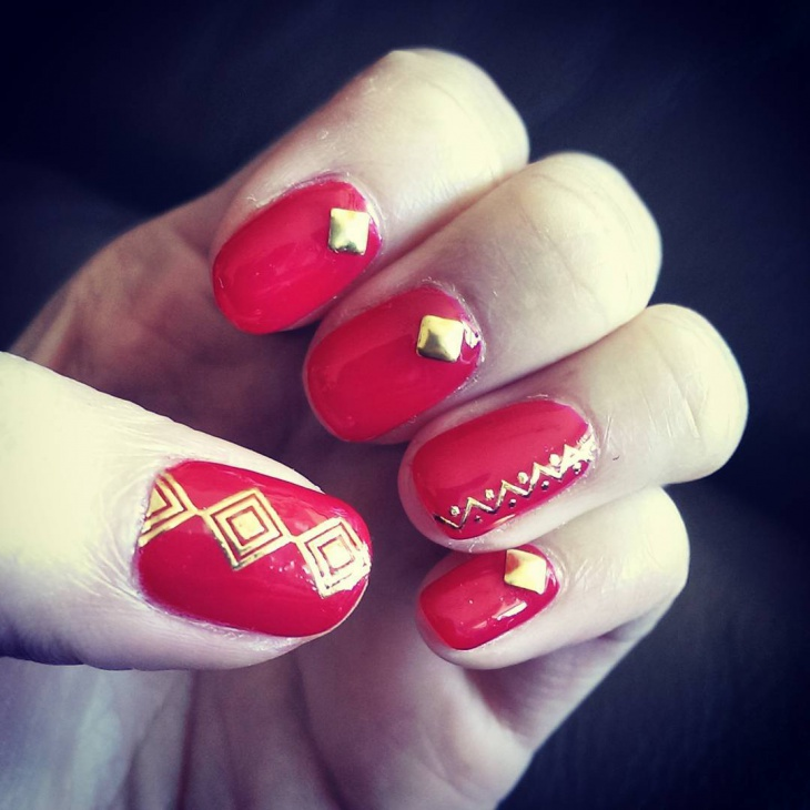 flashy red and gold nail design