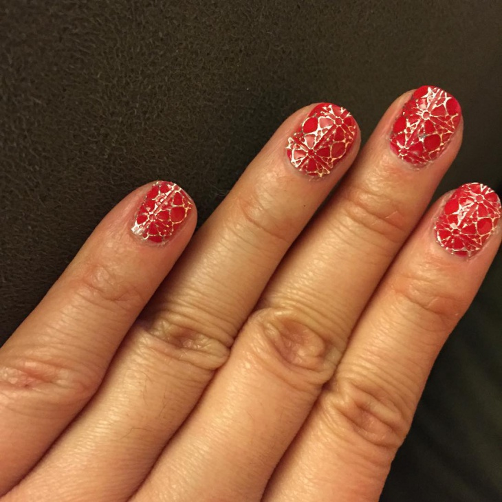 cracked red and gold nail idea