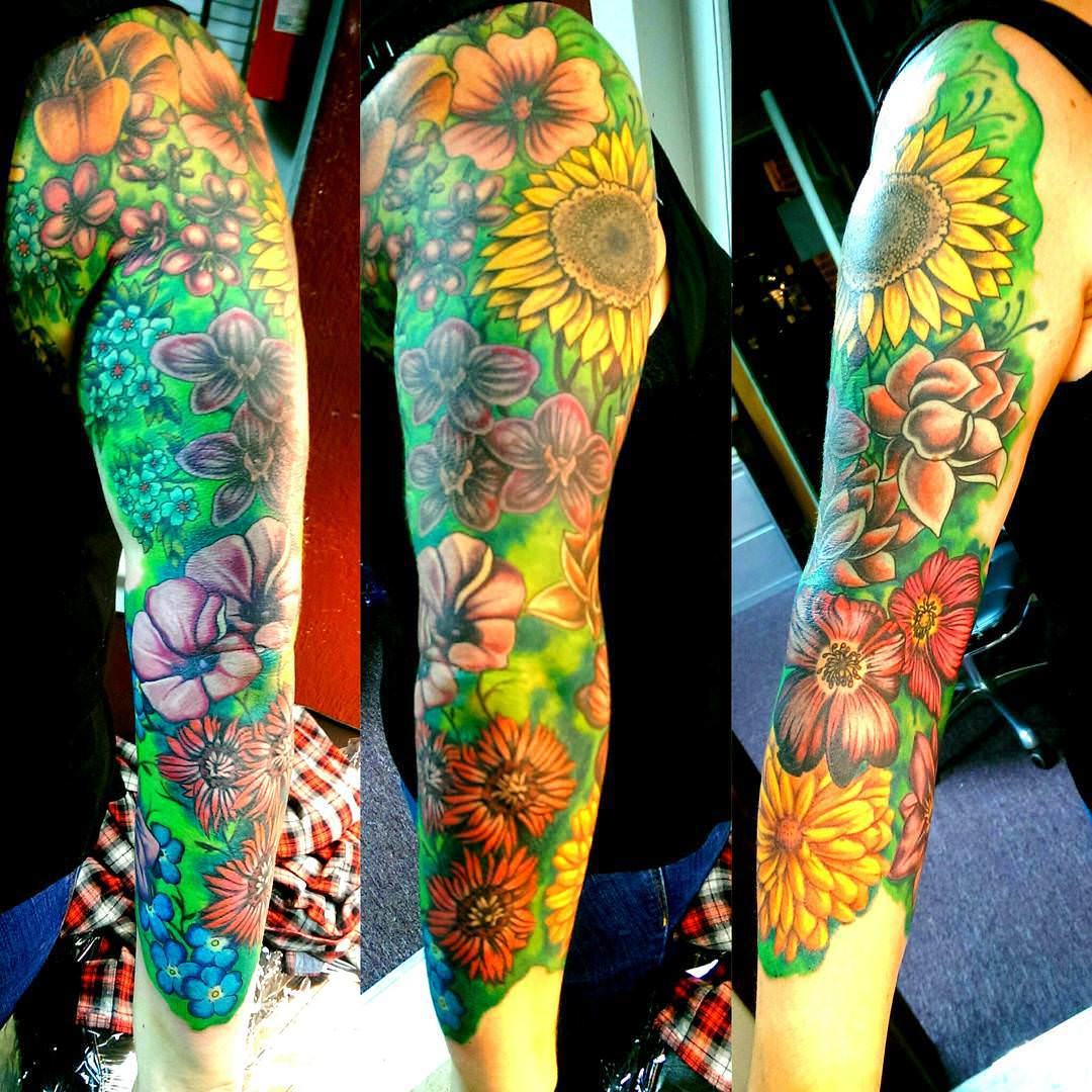Different Colors Flower Sleeve Tattoo