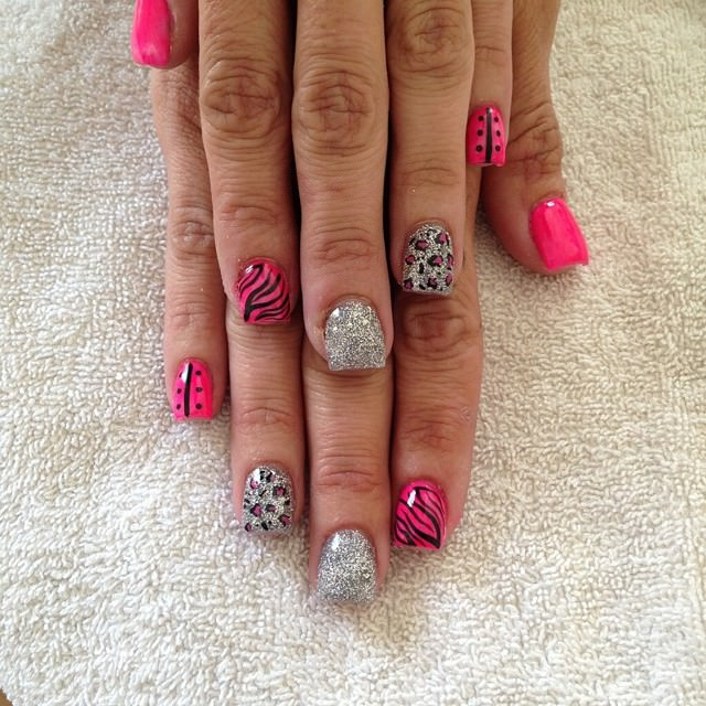 fashionable pink and silver nail design