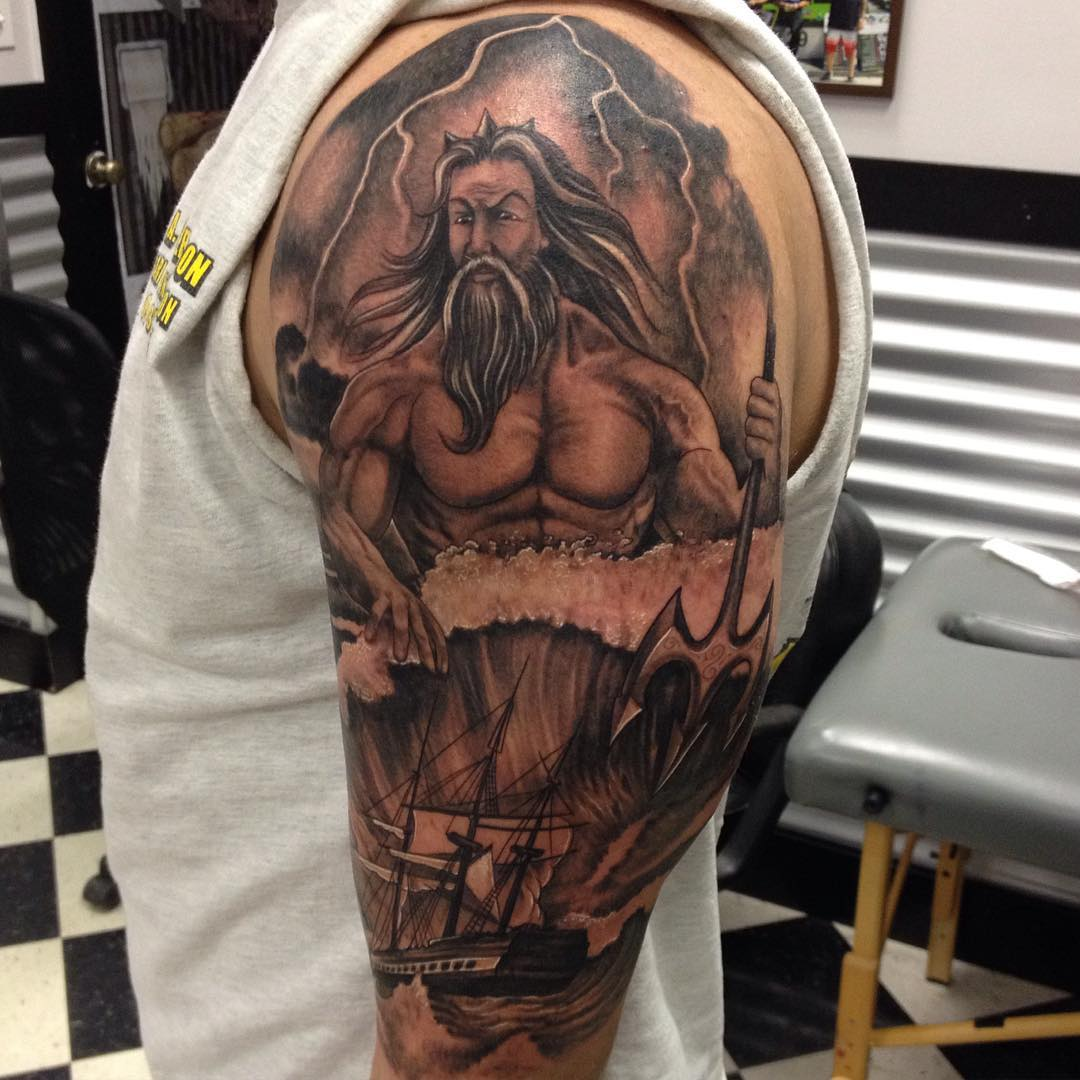 Man on Left Hand With Arm Sleeve Tattoo