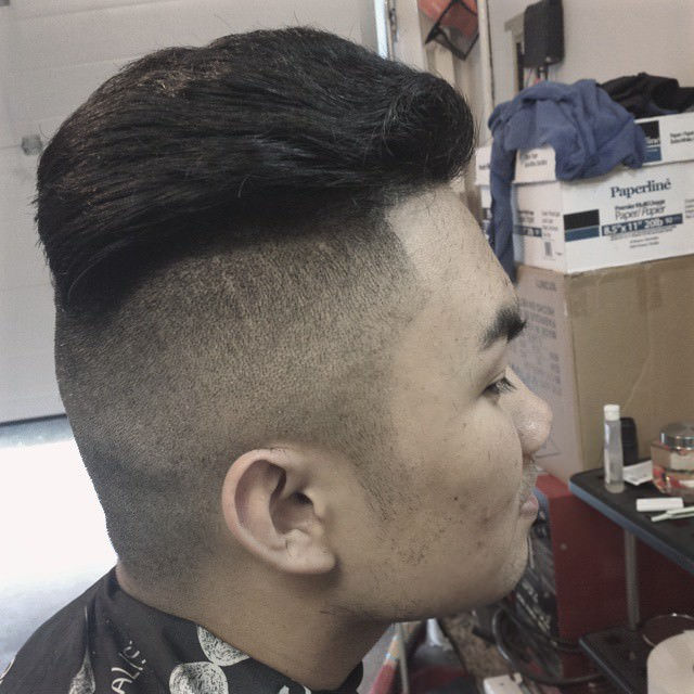Low Fade Haircut with a Shaved Side Part
