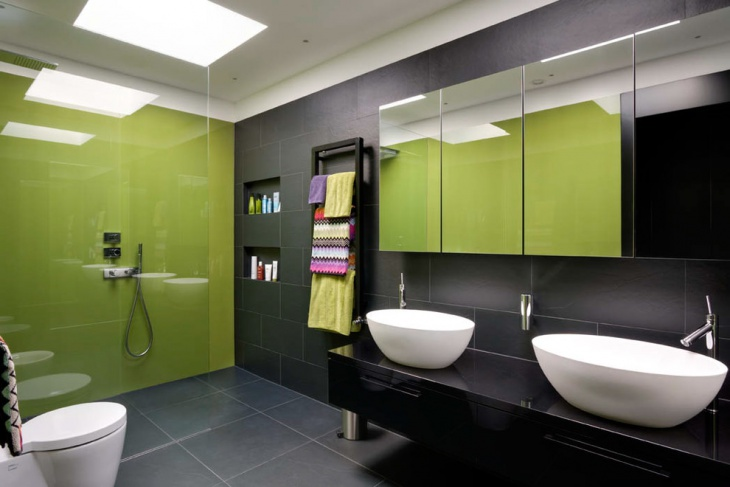 green bathroom with multicolor towels