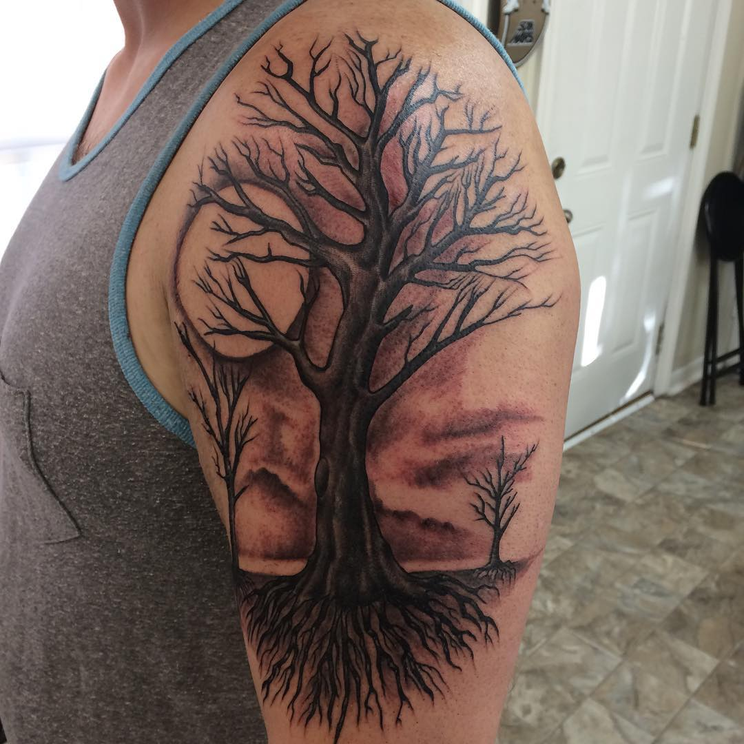 half sleeve tattoo design with tree