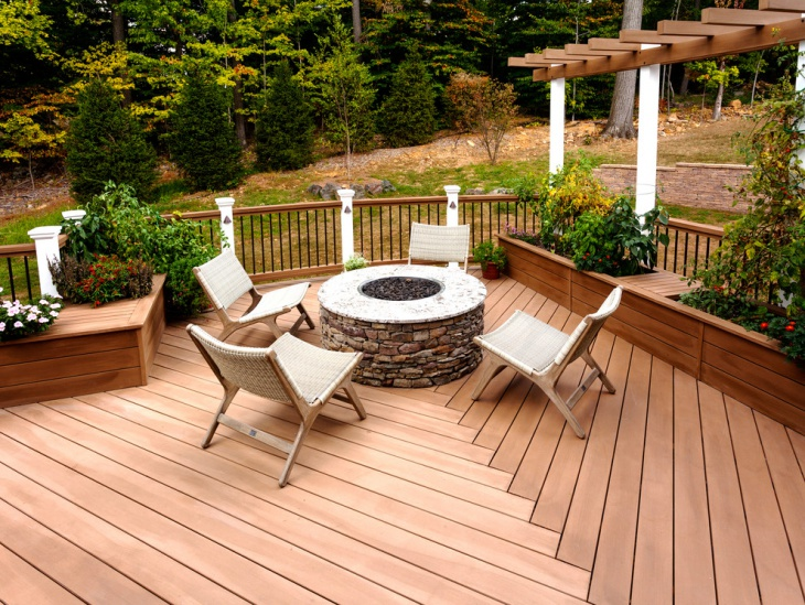 Wood Deck Design With Stone Fire Pit.