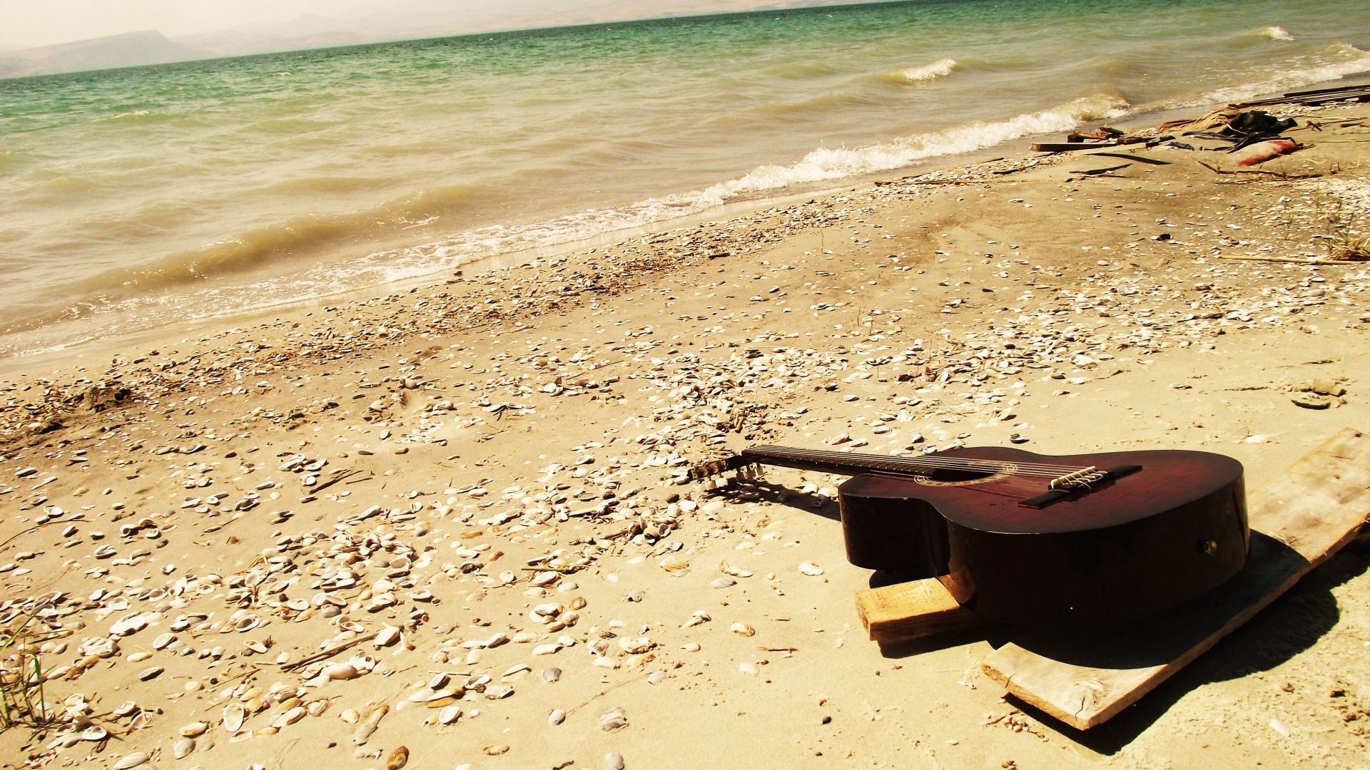 Cool Guitar on Beach hd Background