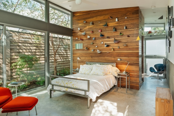 bedroom with wood wall decoration