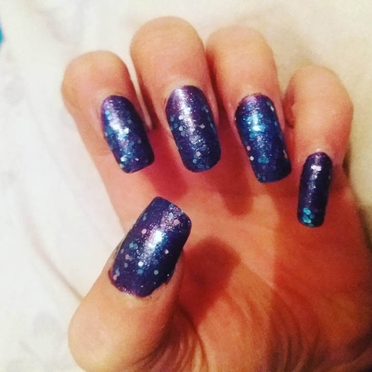 Purple Sparkle Nail Design