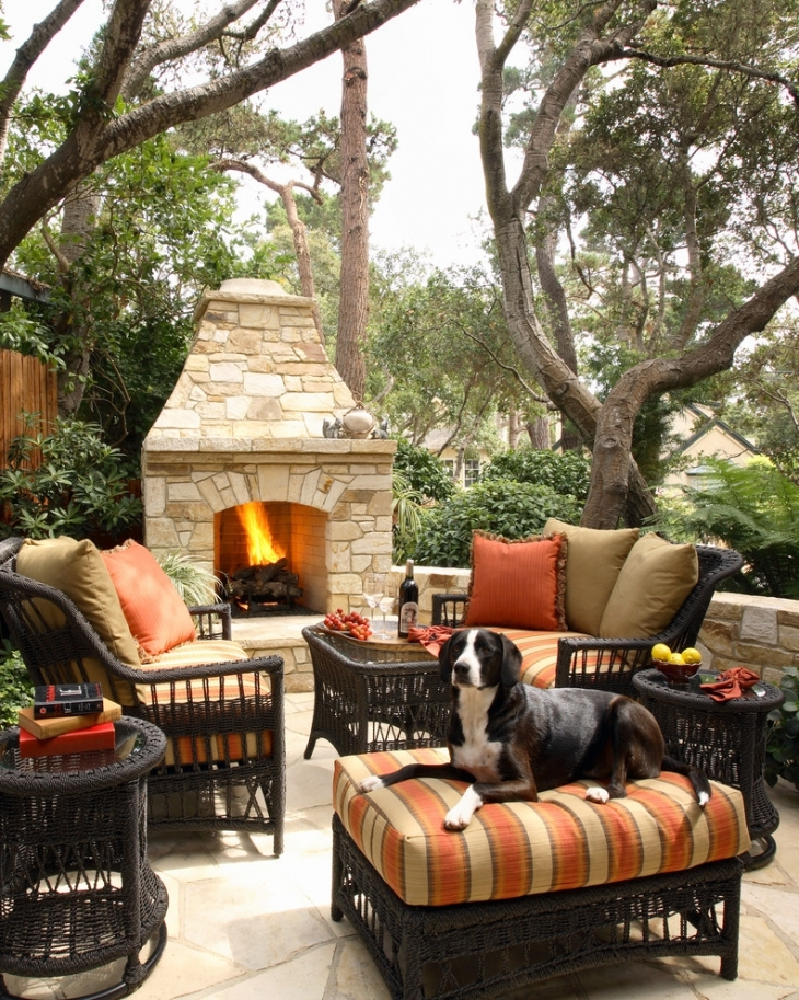 classy patio with fireplace