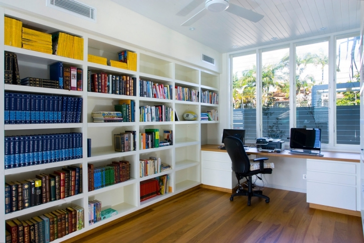 home office with built in book shelves