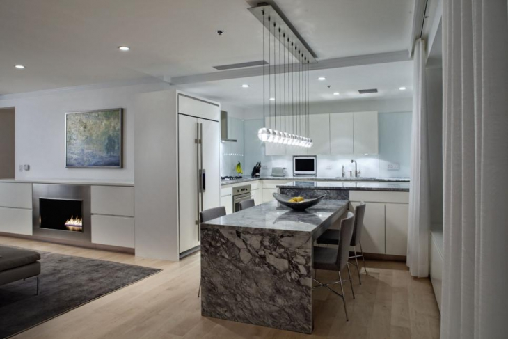 gray and white kitchen with globe light