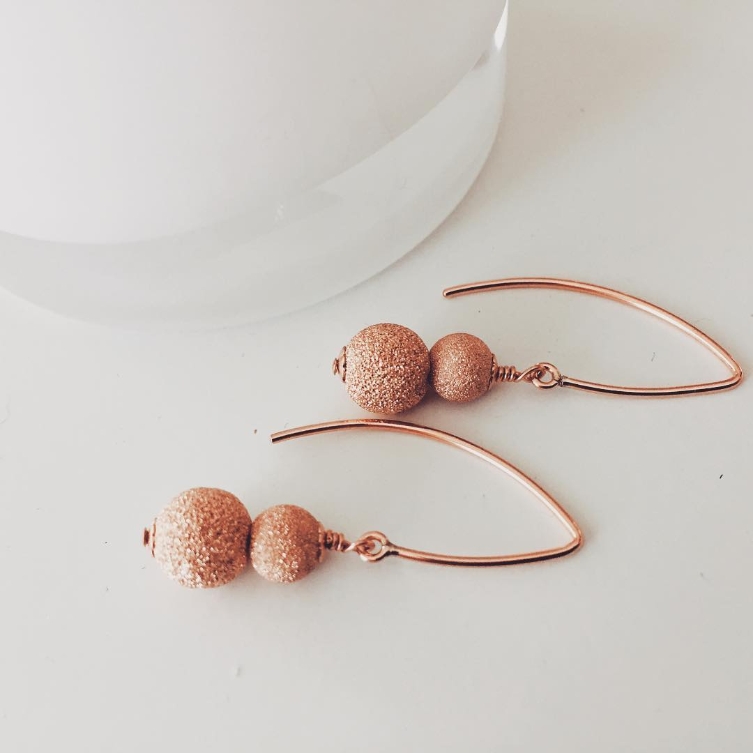 unique style rose gold drop down earrings