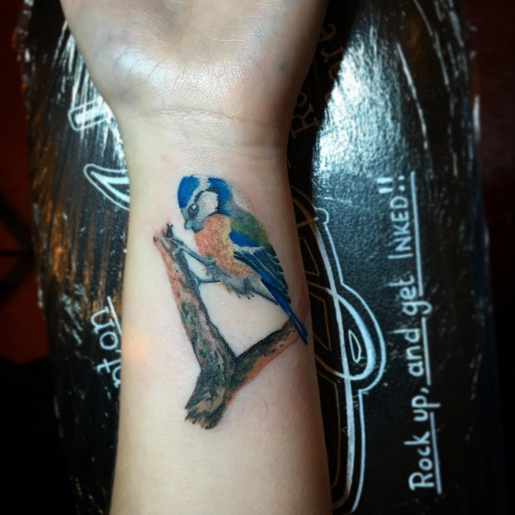 Realistic Bird Wrist Tattoo
