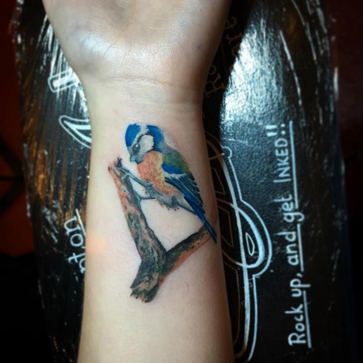 realistic bird wrist tattoo