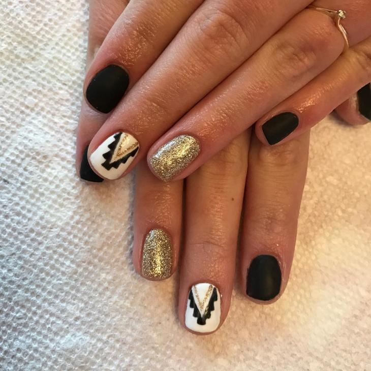 matte black aztec nail design