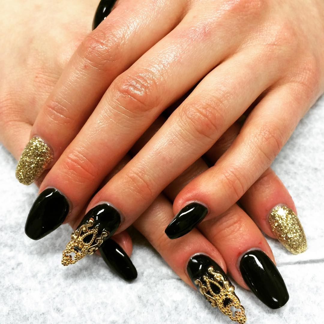 black and golden nail design