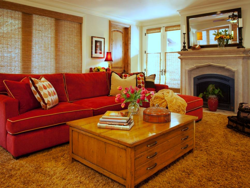 Living room with red couch pictures