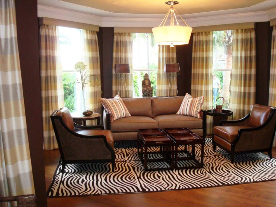 brown living room with plaid drapes