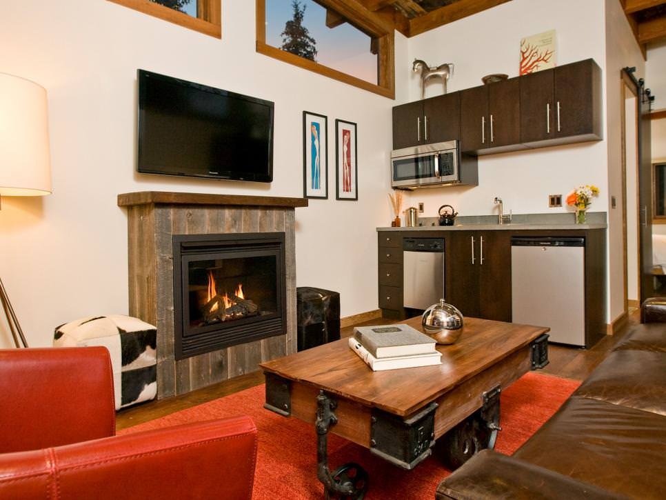 tiny home living room and kitchen with fireplace