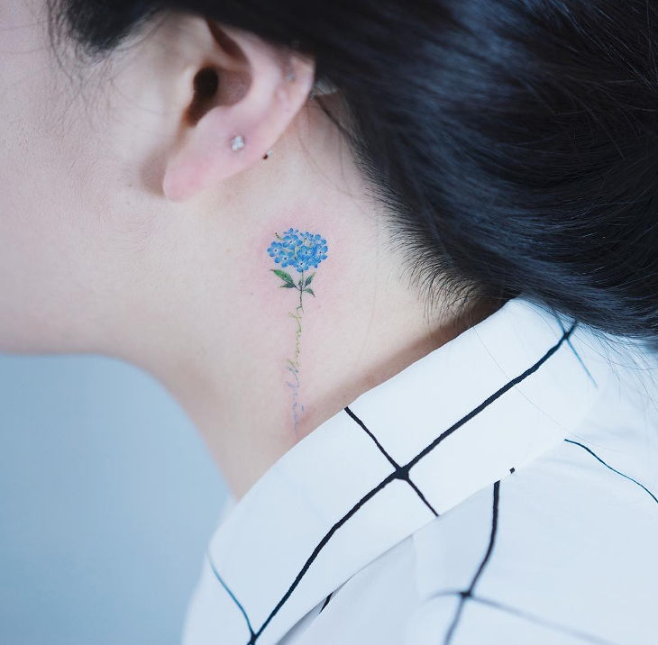 Cute Small Flower Tattoo Below Ear